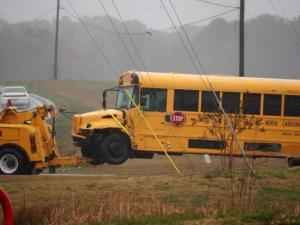 Several students were taken to local hospitals early Wednesday after a wreck involving two vehicles and a school bus near McGee's Crossroads Elementary School in Johnston County, state Highway Patrol officials said.