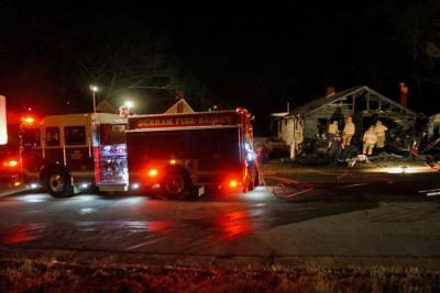 A firefighter was treated for second-degree burns on his hands early Thursday after fire destroyed the front porch of a home on East Weaver Street in Durham, authorities said.