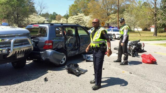 A Fayetteville police officer and state trooper respond to a three-vehicle crash on King Road in Fayetteville on Saturday, April 12, 2014. Photo courtesy of Fred Curley.