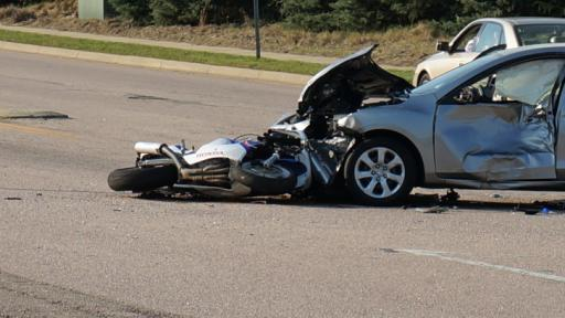Two motorcycles and a silver sedan collided Saturday near the entrance to Triangle Town Center in Raleigh.