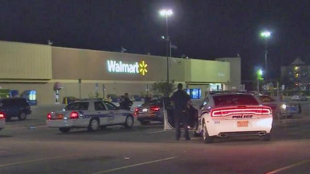 An unidentified man surrendered to Fayetteville police late Tuesday following a 90-minute standoff in the parking lot of a Walmart on Skibo Road.