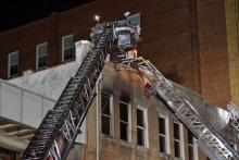 Fire did heavy damage to a three-story building in downtown Durham early Wednesday, authorities said.