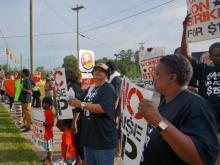 Dozens of protesters turned out at a Burger King location in Durham early Thursday in support of higher pay for workers at fast-food restaurant chains.