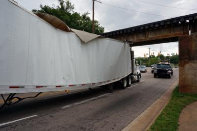 A 53-foot Penske rental truck became the latest to get stuck under the Peace Street Bridge in downtown Raleigh Thursday morning.