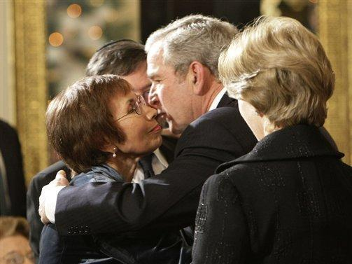 President Bush, right, hugs Ruth Pearl, left, as her husband Professor Judea Pearl, center, watches at the Hanukkah Reception in the Grand Foyer of the White House, Monday, Dec. 10, 2007, in Washington. On the far right is first lady Laura Bush. The Pearl's are the parents of slain journalist Daniel Pearl, a correspondent for the Wall Street Journal, was kidnapped and later beheaded in 2002. (AP Photo/Pablo Martinez Monsivais)