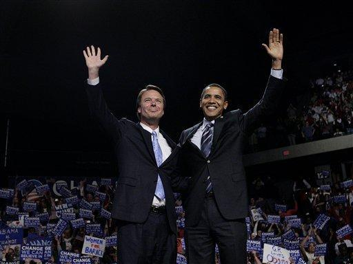 Democratic presidential hopeful, Sen. Barack Obama, D-Ill., right, is joined by former Democratic presidential hopeful, John Edwards, at a rally in Grand Rapids, Mich., Wednesday, May 14, 2008. Edwards endorsed Obama on Wednesday. (AP Photo/Jae C. Hong)