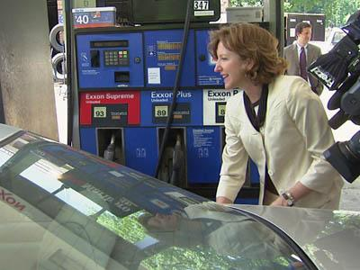 U.S. Senate candidate Kay Hagan pumps gas at a Raleigh station as she talks to drivers about energy policy and the economy on June 18, 2008.