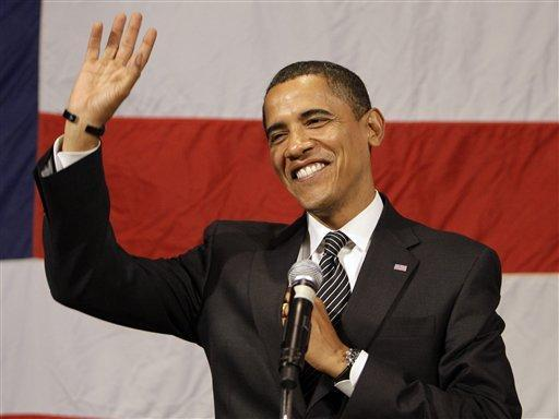 Democratic presidential candidate Sen. Barack Obama, D-Ill., waves before he speaks at the democratic party of North Carolina's annual Vance-Aycock Dinner at The Grove Park Inn in Asheville, N.C. Saturday, Oct. 4, 2008.(AP Photo/Alex Brandon)