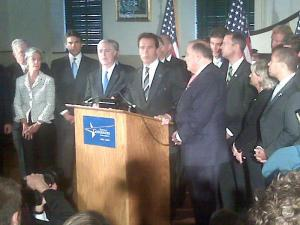 California Gov. Arnold Schwarzenegger, center, and North Carolina Gov. Mike Easley, fourth from left, address the media after a Dec. 2, 2008, meeting between governors and President-elect Barack Obama.