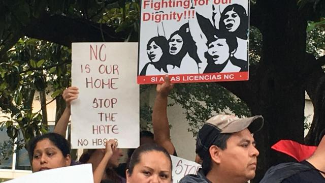 Immigrants and their supporters rally outside the North Carolina Executive Mansion on June 23, 2016, after the U.S. Supreme Court failed to overturn a lower court decision blocking President Barack Obama's deferred-action programs for people in the country illegally.
