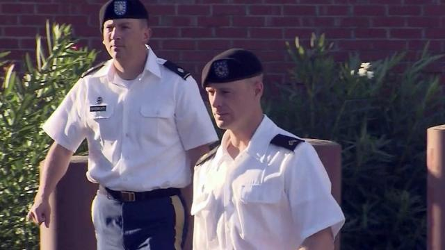 Sgt. Bowe Bergdahl, foreground, walks into a Fort Bragg courtroom on Aug. 22, 2016, for a pretrial hearing in his court-martial.