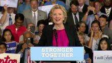 Clinton visits NC wearing big smile