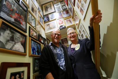 Gerda Saunders, who plans to do doctor-assisted suicide in Europe, poses for photos with her husband Peter surrounded by family photos in their Salt Lake City home on Wednesday, Jan. 11, 2017. (Deseret Photo)