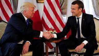 Trump exchanges 'knuckle-crushing' handshake with Macron