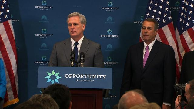 File- House Majority Leader Kevin McCarthy speaks at the weekly House GOP presser about Iran and oil exports. Current Speaker of the House John Boehner stands by his side.