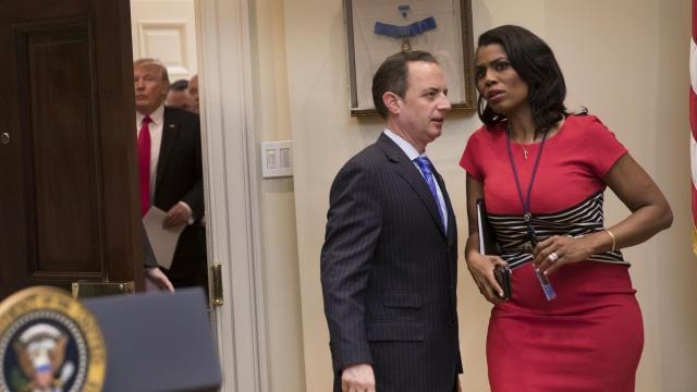 """FILE -- Omarosa Manigault Newman and Reince Priebus, then the White House Chief of Staff , confer as President Donald Trump arrives in the Roosevelt Room of the White House in Washington, Feb. 16, 2017. Manigault Newman, who achieved a measure of fame playing a villain on """"The Apprentice"""" and cemented a relationship with Trump that led to a White House appointment, will be leaving her position in January 2018, the White House said. (Stephen Crowley/The New York Times)"""
