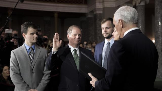 **RETRANSMISSION OF XNYT34 SENT JAN. 3 2018 TO CORRECT DATE TO JAN. 3, 2018 ** Sen. Doug Jones (D-Ala.) during his ceremonial swearing-in by Vice President Mike Pence, in the Old Senate Chamber at the U.S. Capitol, in Washington, Jan. 3, 2018. The arrival of Jones leaves Republicans with a one-seat majority in the Senate. With Jones are his sons Christopher, left, Carson, and his wife, Louise. (Tom Brenner/The New York Times)
