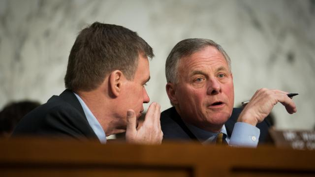 Sen. Richard Burr (R-N.C.), right, chairman of the Senate Intelligence Committee, speaks with Sen. Mark Warner (D-Va.), the ranking Democrat, during a hearing on election security. (Erin Schaff/The New York Times)