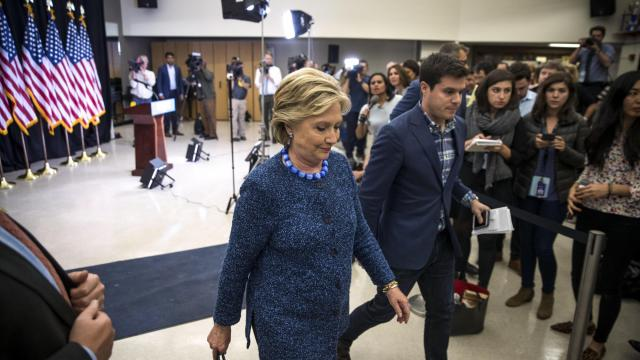 FILE-- Hillary Clinton leaves after making a statement about the FBI's discovery of new emails related to the closed investigation following a campaign event at Roosevelt High School in Des Moines, Iowa, Oct. 28, 2016. The former FBI director James Comey was insubordinate in his handling of the investigation of Clinton during the 2016 presidential election, a critical Justice Department report has concluded as of June 14, 2018, according to officials and others who saw or were briefed on it. (Doug Mills/The New York Times)