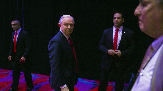 EDS.: RETRANSMISSION TO IMPROVE TONING -- FILE-- Attorney General Jeff Sessions walks off the stage after addressing a crowd at the National Association of School Resource Officers's School Safety and Policing Conference at the Peppermill Resort and Casino in Reno, Nev., June 25, 2018. Sessions pushed back against President Donald Trump's recent attack on him — namely that Sessions never took control of the Justice Department — and said on Aug. 23 that as long as he is the attorney general, he would not be influenced by politics. (Bridget Bennett/The New York Times)