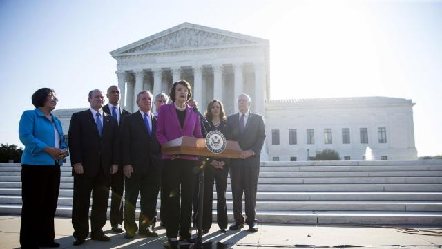 Senate Democrats, with Sen. Dianne Feinstein (D-Calif.) at the lectern, hold a news conference in front of the U.S. Supreme Court on the first day of confirmation hearings for Judge Brett Kavanaugh, President Donald Trump's nominee for the U.S. Supreme Court, in Washington, Sept. 4, 2018. (Eric Thayer/The New York Times)
