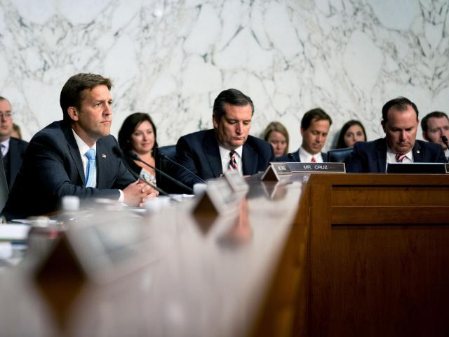 """Sen. Ben Sasse (R-Neb), left, listens during the confirmation hearing for Judge Brett Kavanaugh, President Donald Trump's nominee to the Supreme Court, in Washington on Sept. 5, 2018. Sasse laments that the White House has become a """"three-ring circus."""" (Erin Schaff/The New York Times)"""