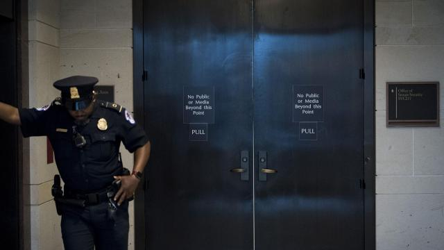 FILE-- A Capitol Police officer last month on Capitol Hill in Washington, Aug. 22, 2018. Neither Republicans nor Democrats want the government to close before the midterm elections, but the president has repeatedly raised the specter of a shutdown. (Erin Schaff/The New York Times)