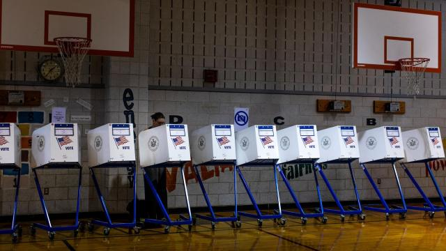 """FILE-- A voter casts a ballot at polling station at PS 705 Brooklyn Arts & Science Elementary School in Brooklyn, New York, Sept. 13, 2018. Russians working for a close ally of President Vladimir Putin engaged in an elaborate campaign of """"information warfare"""" to interfere with the midterm elections, federal prosecutors said on Oct. 19, in announcing they had charged one of them in the plot. The woman, Elena Alekseevna Khusyaynova, 44, of St. Petersburg, was involved in an effort """"to spread distrust towards candidates for U.S. political office and the U.S. political system,"""" prosecutors said. (Demetrius Freeman/The New York Times)"""
