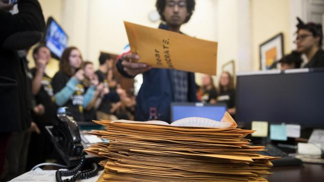 A protester places a letter in a pile during a demonstration by activists from the Sunrise Movement in the offices of House Minority Leader Nancy Pelosi (D-Calif.) on Capitol Hill, in Washington, Nov. 13, 2018. Alexandria Ocasio-Cortez, congresswoman-elect from New York, also made a visit to the protest. (Sarah Silbiger/The New York Times)