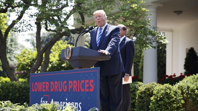 FILE -- President Donald Trump holds a news conference with Alex Azar II, the secretary of health and human services, at the Rose Garden of The White House in Washington, May 11, 2018. The Trump administration proposed on Nov. 26, 2018, to cut costs for Medicare by reducing the number of prescription drugs that must be made available to people with cancer, AIDS, depression, schizophrenia and certain other conditions. (Tom Brenner/The New York Times)