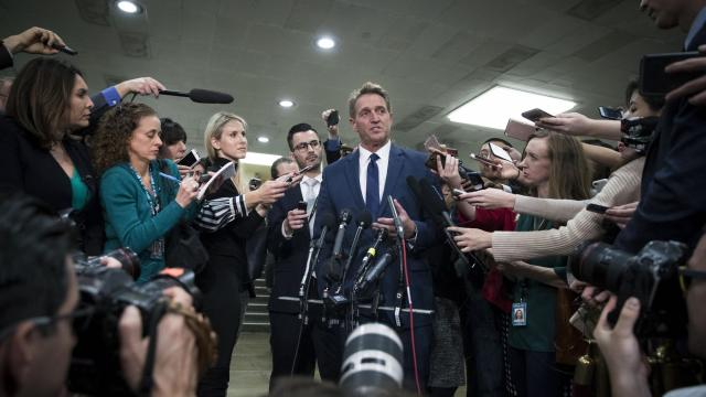 Sen. Jeff Flake (R-Ariz.) speaks to reporters in the Senate Subway after a closed-door, classified briefing with other Senators and Trump administration officials on Capitol Hill, in Washington, Nov. 28, 2018. The Senate is weighing whether to end American support for the conflict in Yemen. Several senators signaled they would use the briefing on Yemen to also ask about the killing of Jamal Khashoggi, the journalist and Saudi dissident. (Sarah Silbiger/The New York Times)