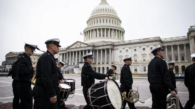 Members of a military band during rehearsal for an upcoming service for former President George H.W. Bush at the Capitol building in Washington, Dec. 2, 2018. With President Donald Trump's apparent blessing, lawmakers are considering a one- or two-week spending bill to set aside negotiations until after Bush's funeral. (Al Drago/The New York Times)