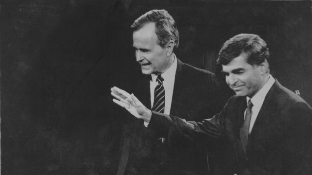 FILE -- George H.W. Bush and Michael Dukakis, his Democratic opponent, after a presidential debate in Los Angeles, Oct. 13 1988. The Willie Horton episode and the political advertising that came to epitomize it remain among the most controversial chapters in modern politics, a precursor to campaigns to come and a decisive force that influenced criminal justice policy for decades. (Jim Wilson/The New York Times)