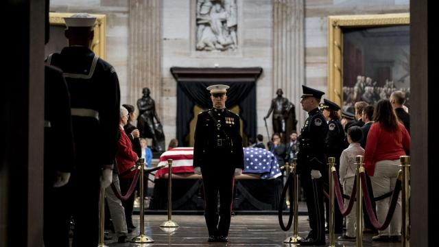 An honor guard stands watch as former President George H.W. Bush lies in state at the Capitol Rotunda in Washington, Dec. 4, 2018. Presidential funerals provide a moment for Washington — and the nation — to pause and embrace the better side of our politics. (Erin Schaff/The New York Times)