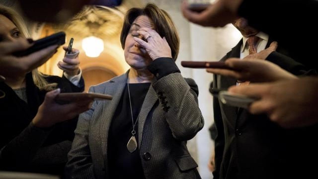 """Sen. Amy Klobuchar (D-Minn.) talks to reporters about sexual harassment legislation on Capitol Hill in Washington, Dec. 12, 2018. House and Senate negotiators, after months of talks, reached a deal to change and toughen the arcane rules governing sexual misconduct claims on Capitol Hill. The current procedures seem """"better designed to protect politicians rather than victims,"""" said Klobuchar. (Erin Schaff/The New York Times)"""