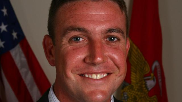 California Republican Rep. Duncan Hunter acknowledged that he posed for a photo with a dead enemy combatant while serving in the US Marine Corps -- arguing that many service members have done the same in an attempt to defend a Navy SEAL chief who is facing charges that could constitute war crimes. (Duncan Hunter Campaign)