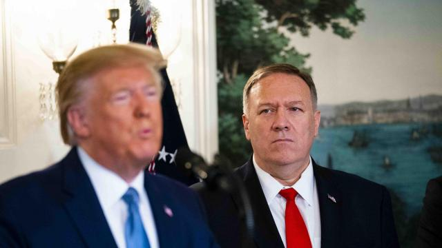 Secretary of State Mike Pompeo looks on as President Donald Trump makes remarks about the Turkey/Syria Border in the at the White House in Washington on Wednesday, Oct. 23, 2019. (Doug Mills/The New York Times)
