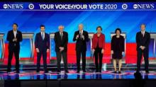 IMAGES: Buttigieg and Sanders clash on the debate stage after close finish in the Iowa caucuses