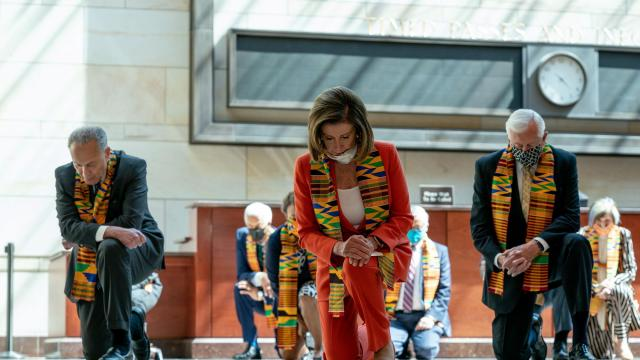 From left: Senate Minority Leader Sen. Chuck Schumer (D-N.Y.), House Speak­er Nancy Pelosi (D-Ca­lif.), and House Majority Whip Steny Hoyer (D-Md.), along with other members of Congress, kneel at the Capitol in Washington, on Monday, June 8, 2020, to protest police injustice and honor George Floyd, an African-American man, who died in Minneapolis police custody. They later unveiled new law enforcement and equal justice legislation. (Anna Moneymaker/The New York Times)
