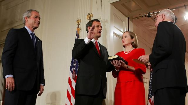 FILE -- John Roberts is sworn in as Chief Justice of the U.S. Supreme Court by Justice John Paul Stevens, as Roberts' wife Jane holds a Bible, with President George W. Bush in the East Room of the White House, Aug. 29, 2005. Roberts has replaced Justice Anthony Kennedy as the member of the Supreme Court at its ideological center, and his vote is now the crucial one in closely divided cases. (Doug Mills/ The New York Times)