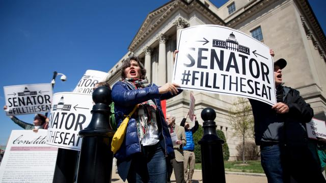 FILE - Protesters outside of Senate Majority Leader Mitch McConnell's (R-Ky.) office in Louisville, Ky., March 21, 2016. The fight over the confirmation of Judge Garland in 2016 set the tone for an even more brutal battle over who should succeed Justice Ruth Bader Ginsburg. (Jessica Ebelhar/The New York Times)