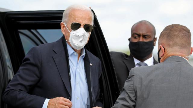 Trump campaign adviser claims Biden's mask is a 'prop' as President hospitalized with Covid-19
