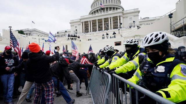 Pro-Trump protesters storm US Capitol as lawmakers gather to count electoral votes