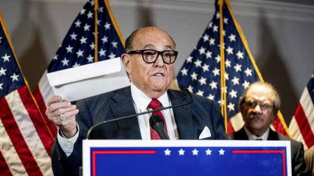 FILE -- Rudy Giuliani speaks during a news conference in Washington, Nov. 19, 2020. During the 2020 campaign, Giuliani arranged meetings with Ukrainians claiming to have damaging information about the Bidens. (Erin Schaff/The New York Times)