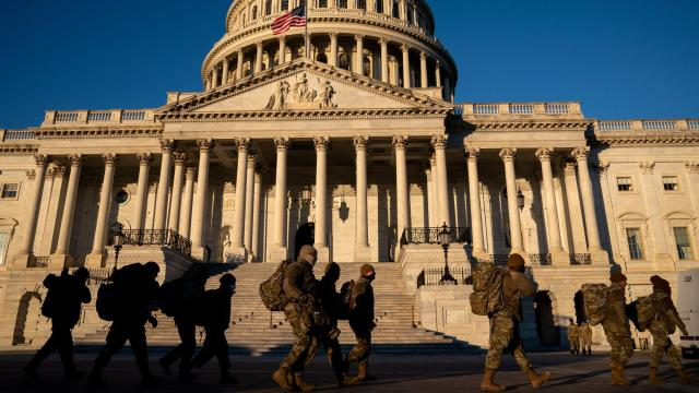 Members of the Army National Guard arrive for a shift at the Capitol Building at sunrise in Washington, Jan. 10, 2021. The military's Joint Chiefs of Staff sent an unusual message to the entire American armed forces on Tuesday reminding them that their job was to support and defend the Constitution, and declaring that Joe Biden would soon be their next commander in chief. (Anna Moneymaker/The New York Times)