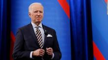 IMAGES: Biden says things may be back to normal by next Christmas