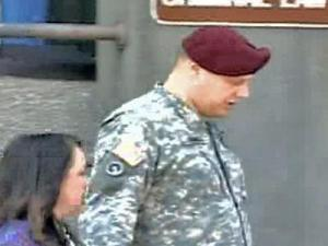 Army master Sgt. Timothy B. Hennis leaves a hearing at Fort Bragg. A hearing officer's recommendation released on Saturday, June 9, 2007, that Hennis face a court martial for three deaths for which a civilian court acquitted him of murder nearly two decades ago.