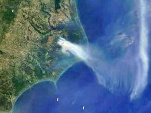 A satellite shows the distribution of smoke from a fire in an eastern North Carolina wildlife refugee just before midnight on June 7, 2008. (Photo courtesy of  Modis Today)