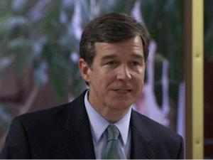 North Carolina Attorney General Roy Cooper addresses a Senate committee meeting Thursday, June 12, 2008, about a bill that would fix state law that would bar mentally ill people from buying firearms.
