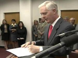 Gov. Mike Easley signs legislation on July 31, 2008, that increases state powers to respond to drought conditions.